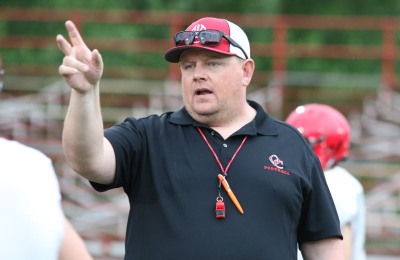 REVIEW/NEWS PHOTO: JIM BESEDA - Oregon City coach Dustin Janz spent the two weeks following Memorial Day introducing the Pioneers to his zone-read option offense and 4-2-5 defense.