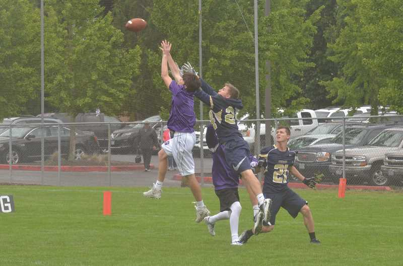 HERALD PHOTO: COREY BUCHANAN -  A Canby and Sunset player leap in the air to catch a deep pass down field.
