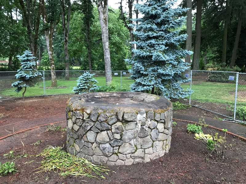 HILLSBORO TRIBUNE PHOTO: GEOFF PURSINGER - ShutePark's Chief Kno-Tah statue was removed from Shute Park on Wednesday, one week after the city said the large wooden statue was too badly damaged to be repaired.
