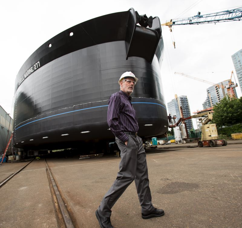 PAMPLIN MEDIA GROUP: JAIME VALDEZ  - Jacked up and ready to launch: Jay Zidell in front of the final (and biggest) barge his company has built at South Waterfront. Next stop: clean up and develop the prime waterfront parcel.