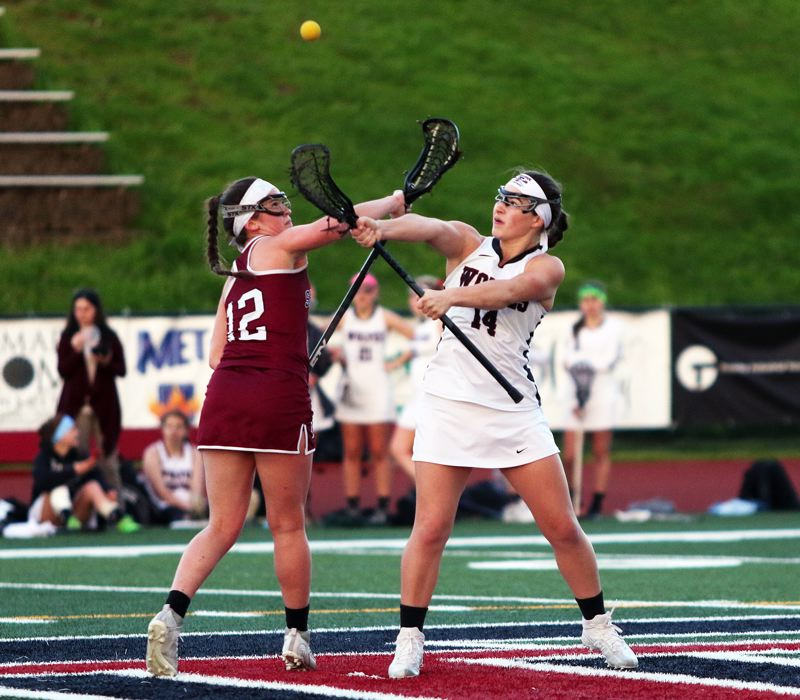 DAN BROOD - Jordan Mitchell (right) was a big-time scorer for the Tualatin girls lacrosse team.