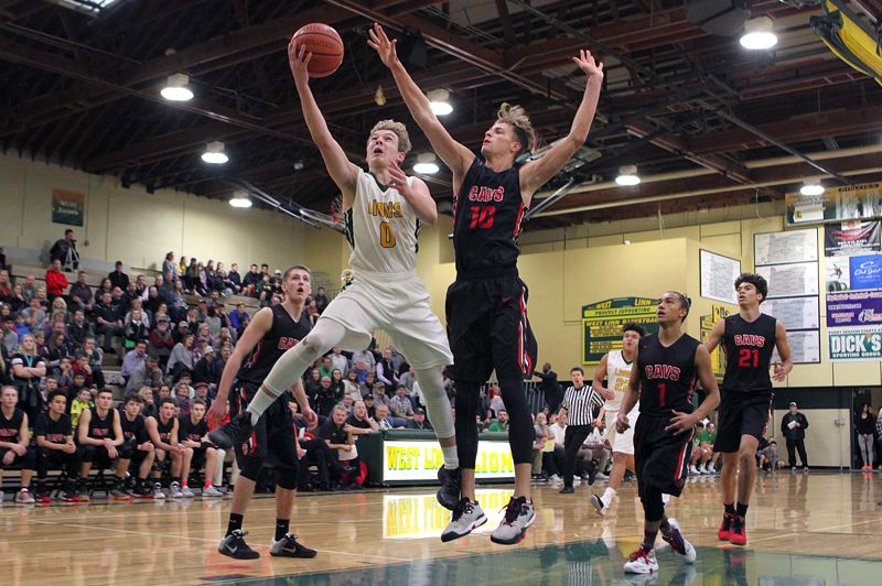 TIDINGS FILE PHOTO - If the OSAA's latest proposals hold, scenes like this one — West Linn vs. Clackamas — could be transformed into regular Three Rivers League games.
