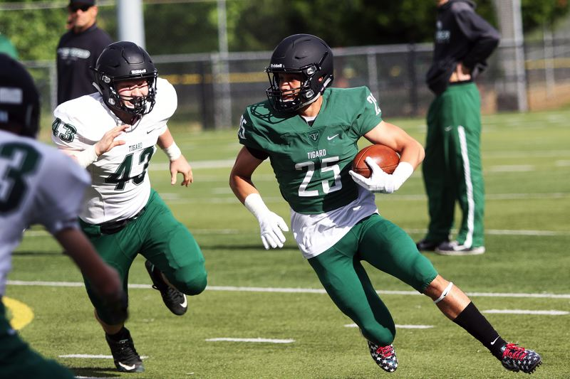DAN BROOD - Tigard senior-to-be Braden Lenzy (25) had 261 total yards and a pair of touchdowns for the winning Green team in the Chicken and Bean Bowl.