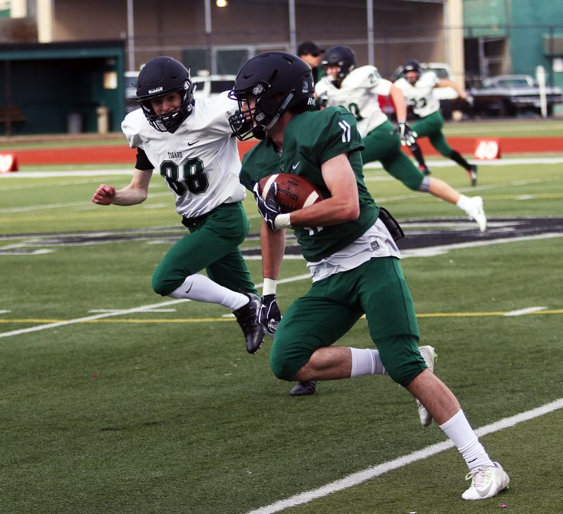 DAN BROOD - Green team receiver Jakob Harrold scored a pair of touchdowns to help his team get a 34-30 win in the Chicken and Bean Bowl.