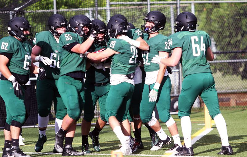 DAN BROOD - The Green team celebrates following the winning touchdown in Saturday's Chicken and Bean Bowl.