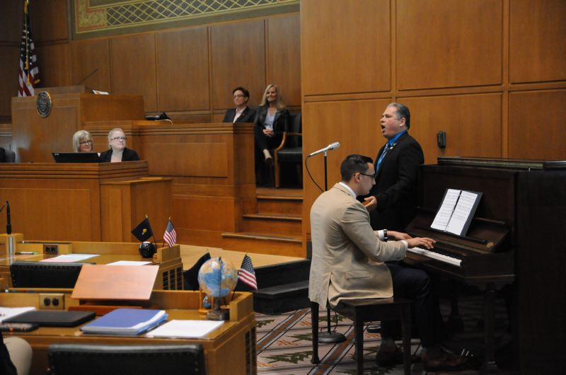 MARTY CARTY/REP. MARK MEEK'S OFFICE - REP. MARK MEEK, D-OREGON CITY, SINGS O SOLE MIO ON THE FLOOR OF THE HOUSE OF REPRESENTATIVES IN SALEM THURSDAY, JUNE 15.