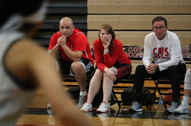 REVIEW/NEWS PHOTOS: JIM BESEDA - Clackamas coach Korey Landolt (middle) sits next to assistants Kevin Berry (left) and Mike Reiner (right) as the Cavaliers' girls' basketball team scrimmaged against West Linn last week.