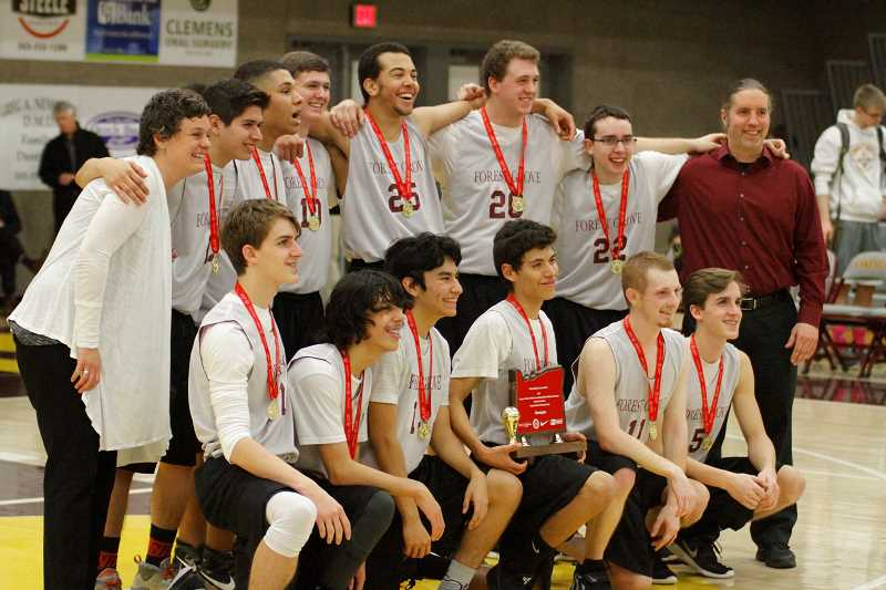 NEWS-TIMES PHOTO: WADE EVANSON - The Forest Grove Unified team poses for a photo after winning the first annual OSAA Unified state championship at Forest Grove High School.