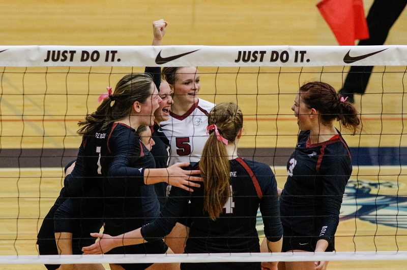 HILLSBORO TRIBUNE FILE PHOTO: CHASE ALLGOOD - Glencoe volleyball players celebrate a point during the Tide's game against South Eugene last season.