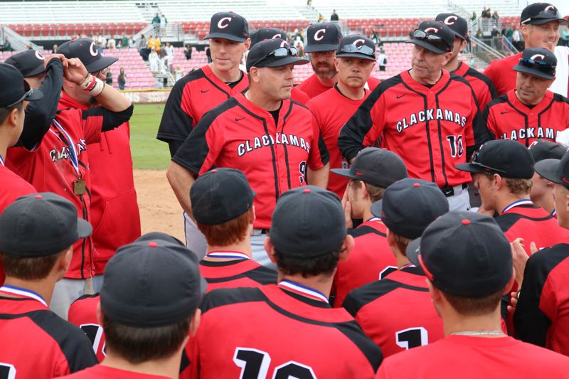REVIEW/NEWS PHOTO: JIM BESEDA - Clackamas coach John Arntson (middle) addresses his team after the Cavaliers clinched the OSAA Class 6A baseball state championship at Volcanoes Stadium in Keizer.