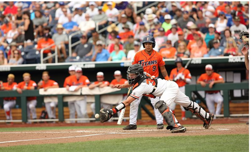 COURTESY: SCOTT CASSIDY - Oregon State freshman catcher Adley Rutschman dives to catch a popped-up bunt.