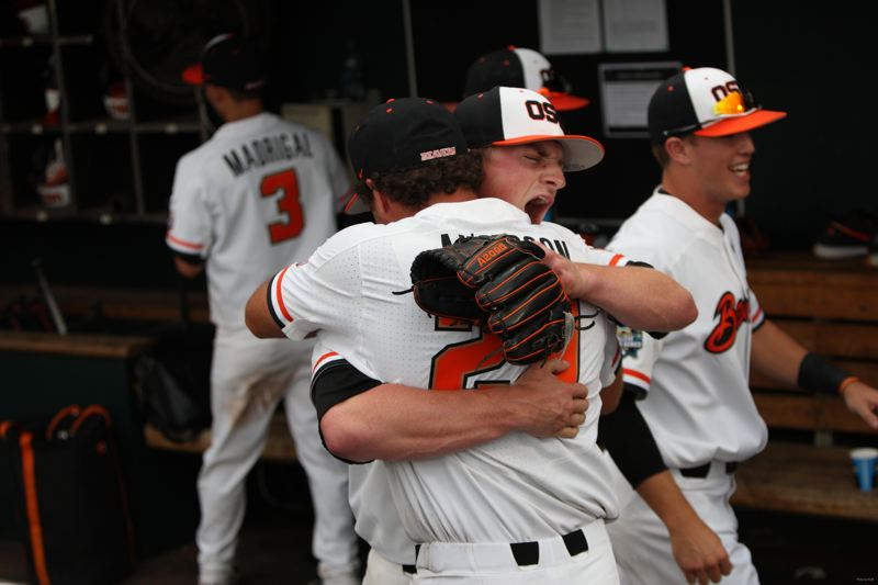 COURTESY: SCOTT CASSIDY - Right fielder Jack Anderson from Lake Oswego High hugs relief pitcher Drew Rasmussen after the final out, as Oregon State advances with a 6-5 win Saturday in the College World Series.