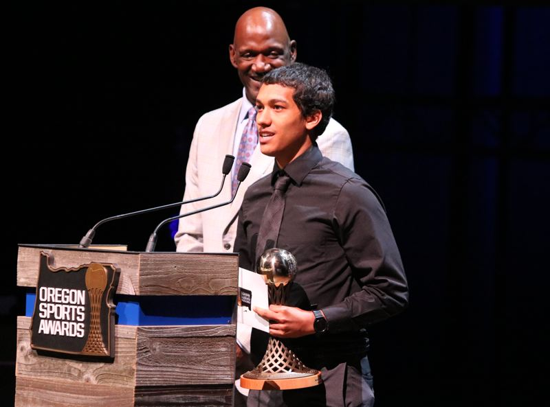 REVIEW/NEWS PHOTO: JIM BESEDA - Clackamas' Elijah Gonzles received the Male Prep Basketball Player of the Year award from University of Portland coach Terry Porter during Sunday's 65th Oregon Sports Awards show.