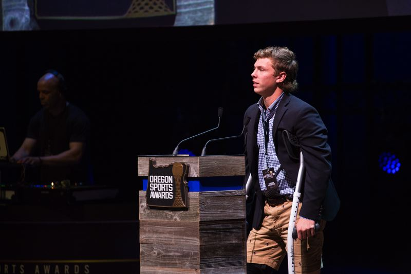 TRIBUNE PHOTO: ADAM WICKHAM - Jesuit High's Tucker Dordevic, mending from a knee injury suffered in the state playoffs, is honored Sunday night at the Oregon Sports Awards as the boys' Prep Lacrosse Player of the Year.