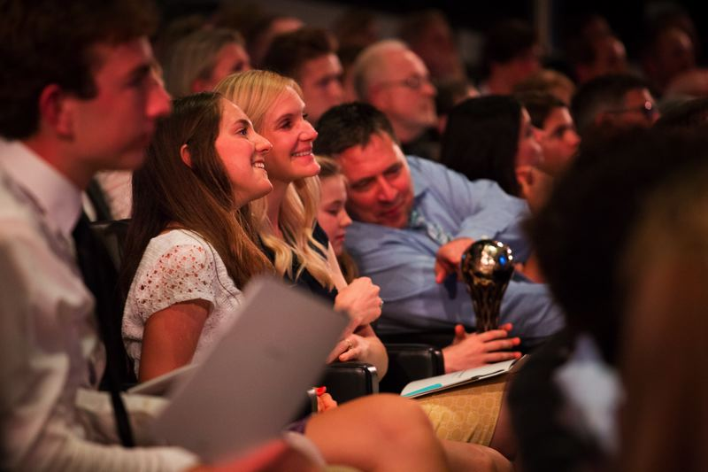 TRIBUNE PHOTO: ADAM WICKHAM - In the audience, the family of Sunset High's Ember Stratton gets a look at the trophy she won as the Prep Cross Country Runner of the Year for females.