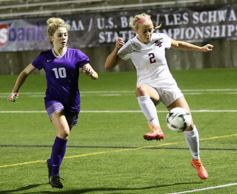 FILE PHOTO: DAN BROOD - Sherwood's Kaillen Fried, 2, shown here in a game against Sunset High School, was named the Prep Soccer Player of the Year during an awards ceremony held June 18 at the Stanford Theater in the Tiger Woods Center on the Nike World Headquarters.