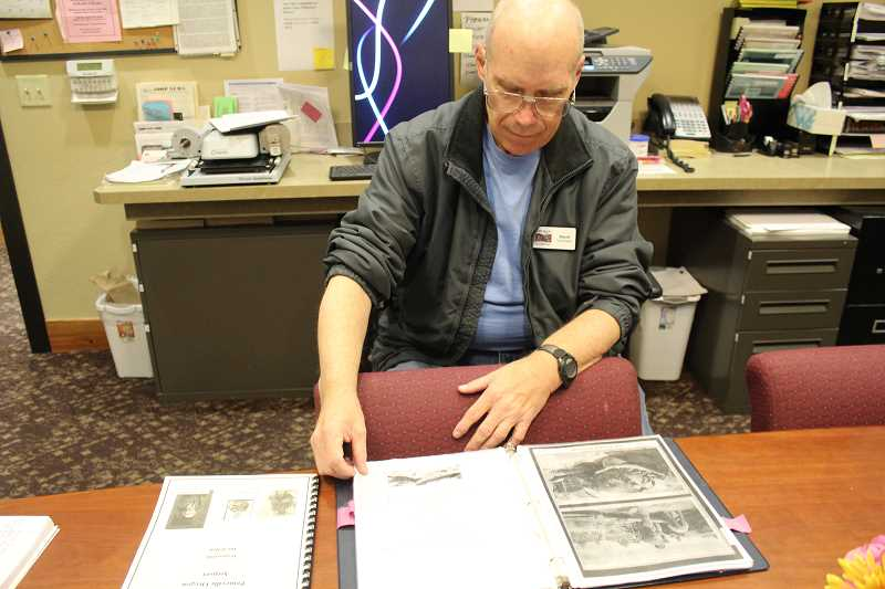 JASON CHANEY - David Hale thumbs through the book he created about the 1935 crash that took the lives of Lt. Wistar Rosenberg and Cpt. Harry Killpack.