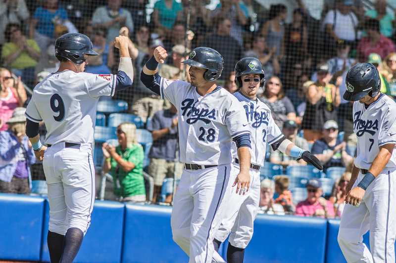 HILLSBORO TRIBUNE FILE PHOTO: CHASE ALLGOOD - Hillsboro Hops players celebrate a grand slam during a game last season.