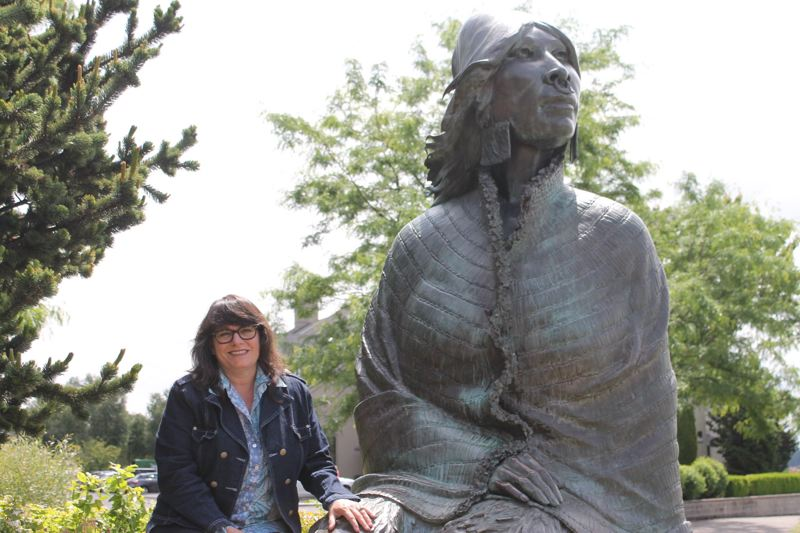 TRIBUNE PHOTO: LYNDSEY HEWITT - Author and historian Tracy Prince, along with her daughter, Zadie Schaffer, together authored a book called 'Notable Women of Portland.' Prince sits next to a statue of Ilchee, daughter of Chinookan Chief Concomly that overlooks the Columbia River at Vancouver's Waterfront Renaissance Park.