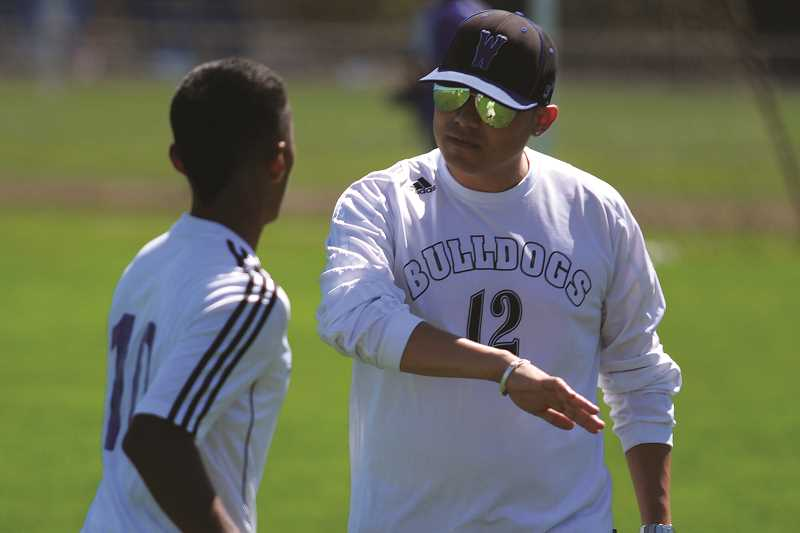 PHIL HAWKINS - Former assistant coach Leroy Sanchez (right) takes over the program after serving under Baker for each of the past four seasons. Sanchez said he will continue to use the same possession-based system that Baker implemented.