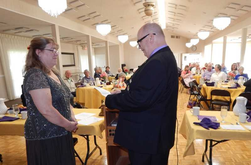 BARBARA SHERMAN - In the King City Clubhouse banquet room, outgoing King City Lions Club president Scott Stierle swears in 2017-18 President Cindy Nemec, who said she 'has big shoes to fill' in continuing the great strides the club has made this year.