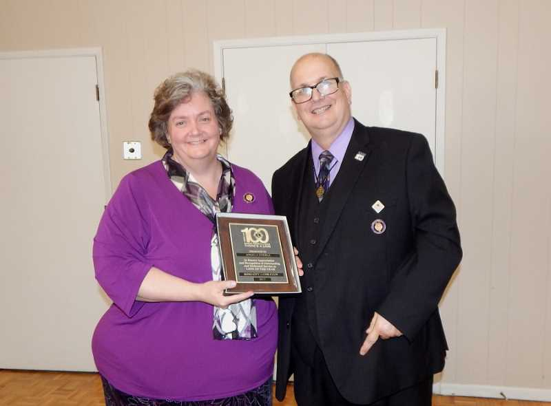 BARBARA SHERMAN - Scott Stierle, outgoing King City Lions Club president, hands the Lion of the Year Award to Angela Stierle, who coincidentally is his wife and club secretary, a role she will continue for the 2017-18 year.