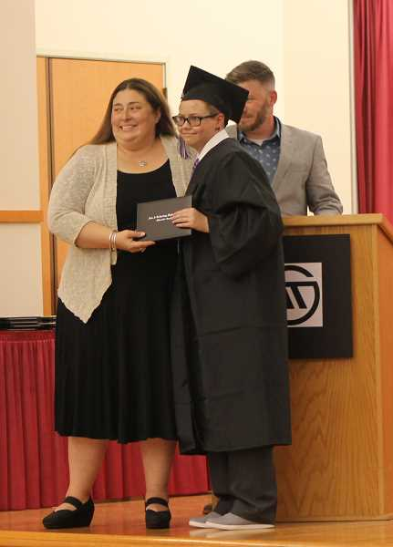 SPOKESMAN PHOTO: ANDREW KILSTROM - Art Tech graduated a record 33 students Tuesday, June 13.