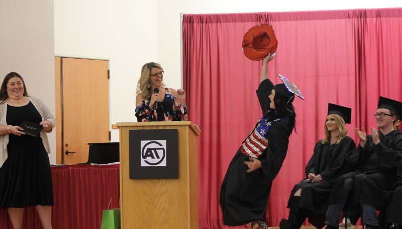 SPOKESMAN  PHOTO: ANDREW KILSTROM - Art Tech counselor Sheri Erhardt, left, gives 2017 graduate Ana Ruiz with a red cowboy hat ahead of receiving her diploma Tuesday, June 13.