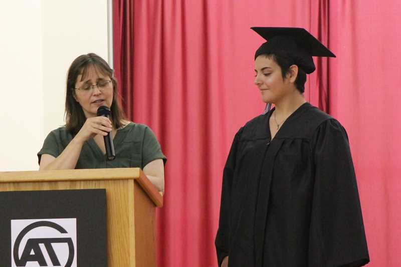 SPOKESMAN PHOTO: ANDREW KILSTROM -  Counselor Cheryl Wilson introduces 2017 graduate Alexandra Heacock June 13.