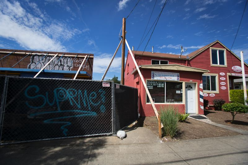 PORTLAND TRIBUNE: JAIME VALDEZ - The new restaurant next to the Brame family building is being built to the property line, eliminating the driveway that used to allow PP&L to read its meter.