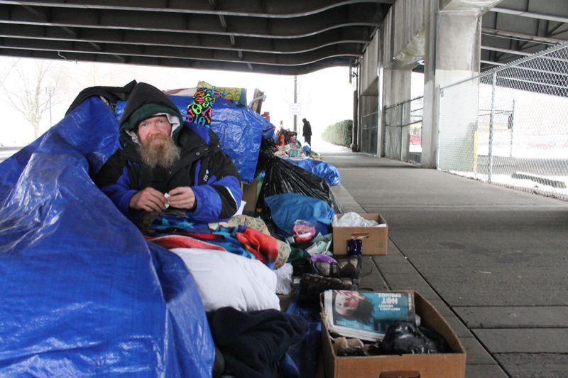 PORTLAND TRIBUNE: LYNDSEY HEWITT - A man stayed under Morrison Bridge earlier this year. Volunteers and outreach workers counted 4,177 homeless people in Portland for the 2017 Point-in-Time count.