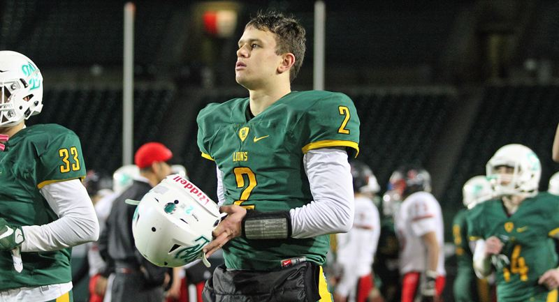 TIDINGS PHOTO: MILES VANCE - West Linn's Tim Tawa used vision and ability like no one else to help lead the Lions to the first state football championship in school history.