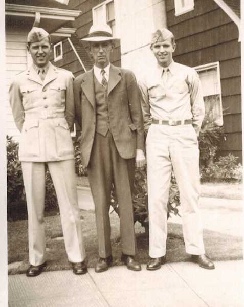 COURTESY OF BOB SANTEE - In July 1945, Bob Santee (left) posed with his dad and brother Bud, who served in the Air Force.