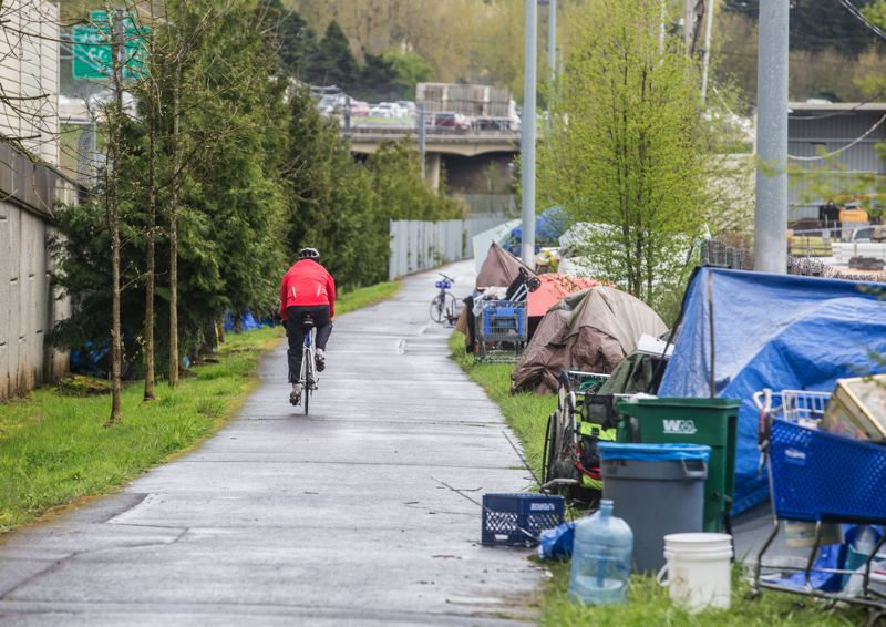 TRIBUNE PHOTO: JONATHAN HOUSE - Campers along the I-205 Multiuse Path in Southeast Portland this spring.