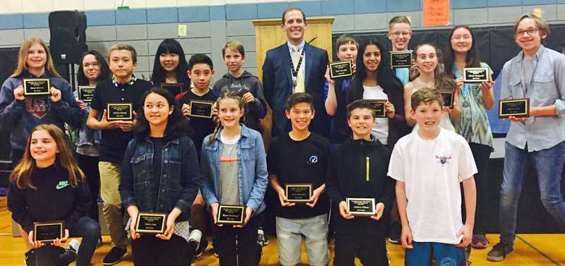 SUBMITTED PHOTO: COURTESY OF LJHS - Lakeridge Junior High School Principal Kurt Schultz beams in the back row, surrounded by Super Students who won one of the highest awards at LJHS.