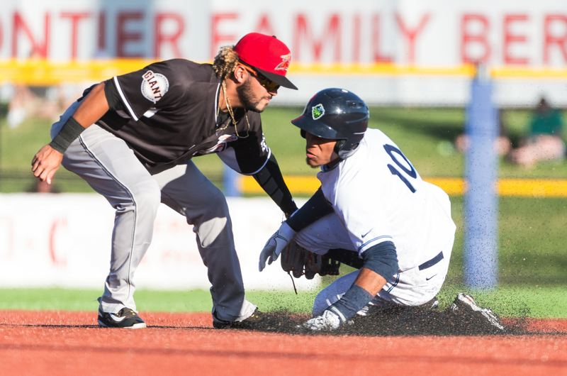 HILLSBORO TRIBUNE PHOTO: CHRISTOPHER OERTELL - Hillsboro Hops second baseman Yan Sanchez (10) is tagged out at second base during a Minor League Baseball game against the Salem-Keizer Volcanoes at Ron Tonkin Field in Hillsboro.