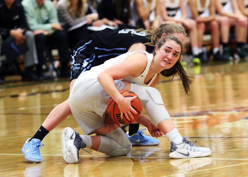 DAN BROOD - As she usually did, Lexie Sawin scrambled to grab a loose ball during a Tigard High School girls basketball game this past season.