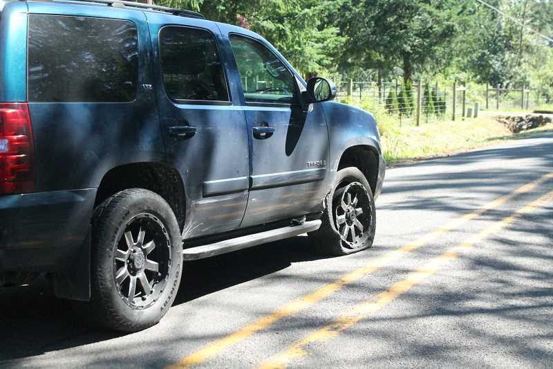PIONEER PHOTO: CONNER WILLIAMS - A Chevrolet Tahoe belonging to a nearby resident suffered moderate damage after fire officials said it was hit by a Subaru Outback that was turning onto Windy City Road from Salo Road in Mulino just before 10 a.m. on Thursday, June 22.