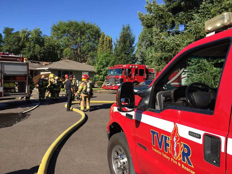 PAMPLIN MEDIA FILE PHOTO - Tualatin Valley Fire and Rescue firefighters respond to a house fire near Westview High School in 2015. TVF&R will officially annex Washington County Fire District 2, which includes North Plains, on July 1.