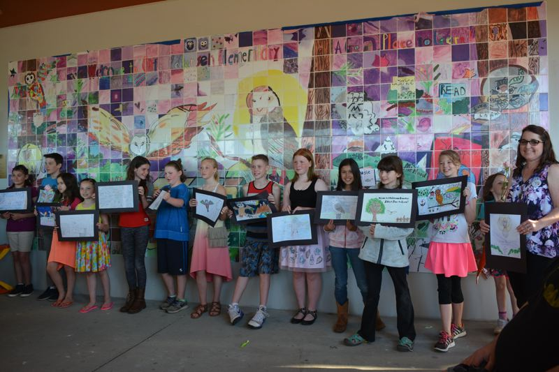 SPOTLIGHT PHOTO: COURTNEY VAUGHN - Students at Otto Petersen Elementary School stand in front of a newly unveiled tile mosaic on Wednesday, June 21.