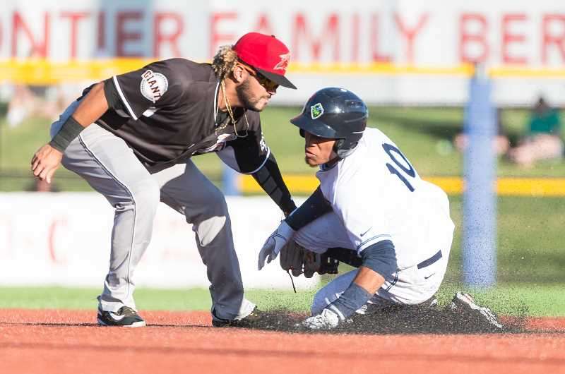 HILLSBORO TRIBUNE PHOTO: CHRISTOPHER OERTELL - Hops shortstop Yan Sanchez slides into second base. The Hillsboro utility man had a tough day in the field, commiting two costly errors in an 8-6 defeat.