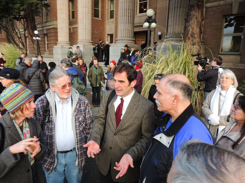 CONTRIBUTED - Ken Ward, center, speaks with supporters outside the Skagit County Courthouse in Mount Vernon, Wash., earlier this year.