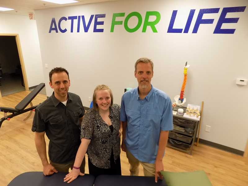 GAZETTE PHOTO: RAY PITZ - Matt Whitaker, a physical therapist; Caitlyn Jensen, a patient care specialist; and Matt Weissbach, also a physical therapist, are there to serve at the recently opened Evolve Physical Therapy in Sherwood.