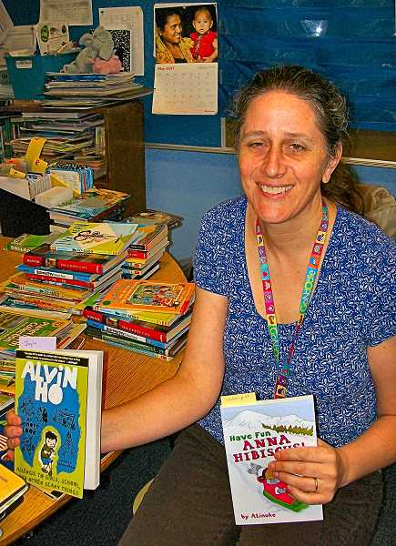 RITA A. LEONARD - Creston Reading Specialist Greta Bergren shows THE BEE some of the books being mailed to kids this summer to encourage their reading skills.