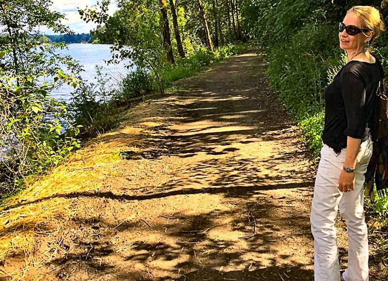 DAN OFLAHERTY - Audry OFlaherty stands on the new dirt trail extending south from the west end of the Sellwood Bridge.