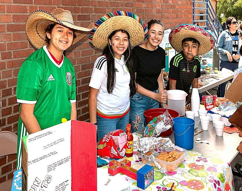 DAVID F. ASHTON - Representing Mexico, at the Holy Family Catholic School International Fair are, from left: Alejandra Garcia, Gabriella Morales-Cortez, Margaux Johnson, and Pablo Morales-Cortez.