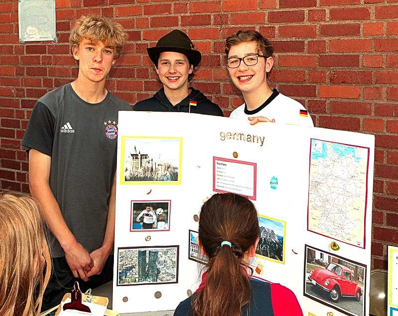 DAVID F. ASHTON - All with some degree of Germanic heritage, and telling about Germany at the fair, were Eli Brunelle, Kyle Diesing, and Xander Immorth.