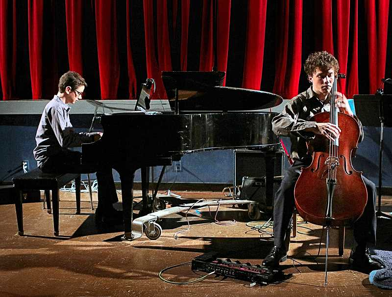 DAVID F. ASHTON - Mixing musicianship with technology, cellist Jesse Fuller performed his composition, Pulse, accompanied by Eli Hilton on the piano.