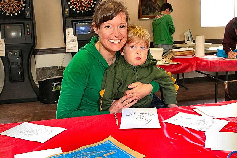DAVID F. ASHTON - Josie Scott helps 2?-year-old MaTeyo make his own original T-shirt design, during the Second Saturday Community Art Program in Brentwood-Darlington, at the Portland Moose Lodge.