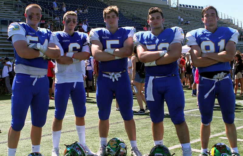 TIDINGS PHOTO: MILES VANCE - West Linn's (from left) Jake Porter, Justin Altenhofen, Mitch Johnson, Connor Maloney and Jake Meisen stood together one last time at the conclusion of Saturday's Les Schwab Bowl.